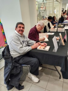 Signing Bato's Book at the Book Fair at the Lake County Public Library